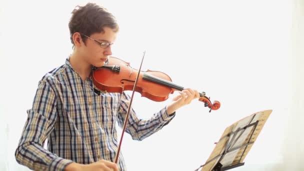 Boy musician with violin