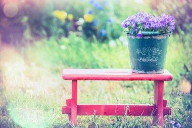 Vintage bucket with garden flowers
