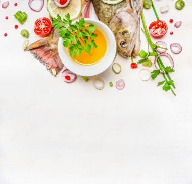 fresh fish with cooking ingredients