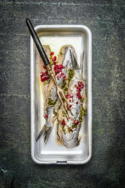 Fresh salted herring with onions