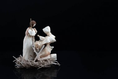 Christmas nativity scene with three Wise Men presenting gifts to baby Jesus, Mary Joseph