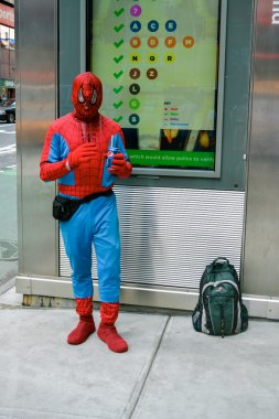 NEW YORK - CIRCA 2014. Men dressed as a Spider-man costume on the street in New York