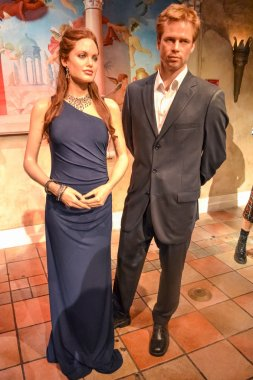 NEW YORK, CIRCA 2011 - Wax portraits of Angelina Jolie and Brad Pitt in evening outfits at Madame Tussaud's museum in New York