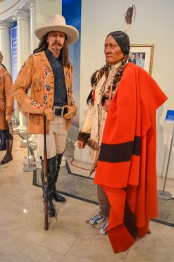 Cowboy and native Red Indian wax figures in Madame Tussaud's museum in New York