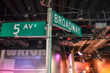 5th ave and Broadway street sign in Madame Tussaud's museum in New York