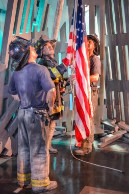 Wax Portraits of Firefighters Raising Flag in Madame Tussaud's museum in New York