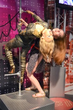 NEW YORK, CIRCA 2011 - Girl posing with Britney Spears wax figure in Madame Tussaud's museum in New York