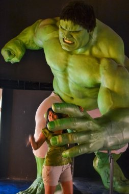 NEW YORK, CIRCA 2011 - Huge Hulk wax figure catches a girl in Madame Tussaud's museum in New York