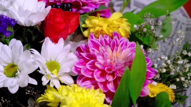 Rotating beautiful bright bouquet of multicolored chrysanthemum and rose flowers. Best gift for a woman.
