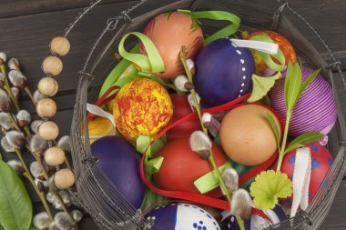 Easter eggs on wooden background. Eggs Easter symbol. Celebration of new life and spring.