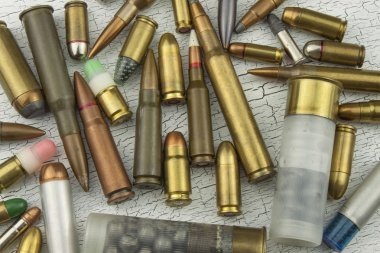 Different types of ammunition. Bullets of different calibers and types. The right to own a gun. Sales of weapons and ammunition.