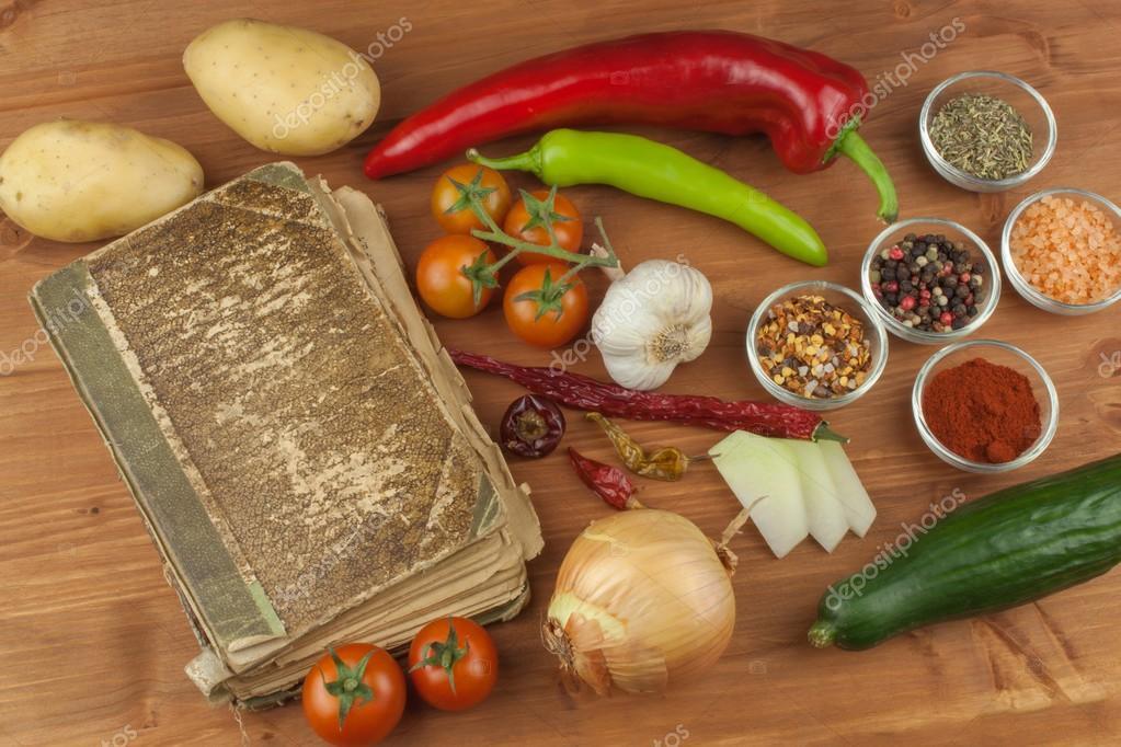 Old cookbook recipes on a wooden table cook healthy vegetable old cookbook recipes on a wooden table cook healthy vegetable preparation of home diet food different kinds of vegetables foto de marsan forumfinder Images