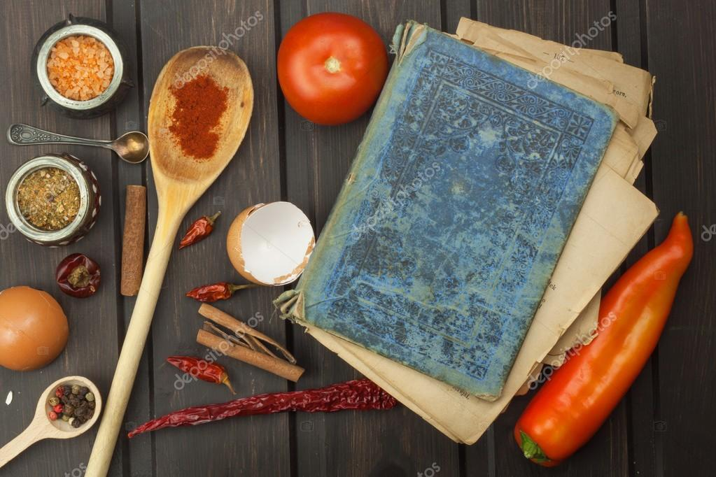 Recipe book and vegetables chili pepper and tomatoes food recipe book and vegetables chili pepper and tomatoes food preparation according to the old forumfinder Choice Image
