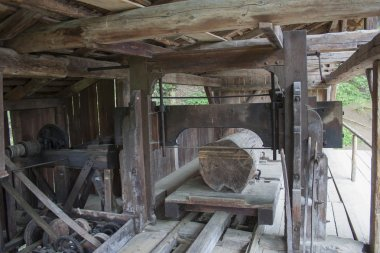 Vesely Kopec, Czech Republic-May 7,2014: Skanzen Vesely Kopec, folk architecture, typical Czech rural building, historical industrial wood products - sawmill cutting through logs, water mill