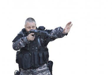 Fight against terrorism, Special Forces soldier, with assault rifle, police swat, gives a stop command, isolated on white