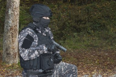 Special anti-terrorist squad, coached at the shooting range, kneeling shooter, police swat