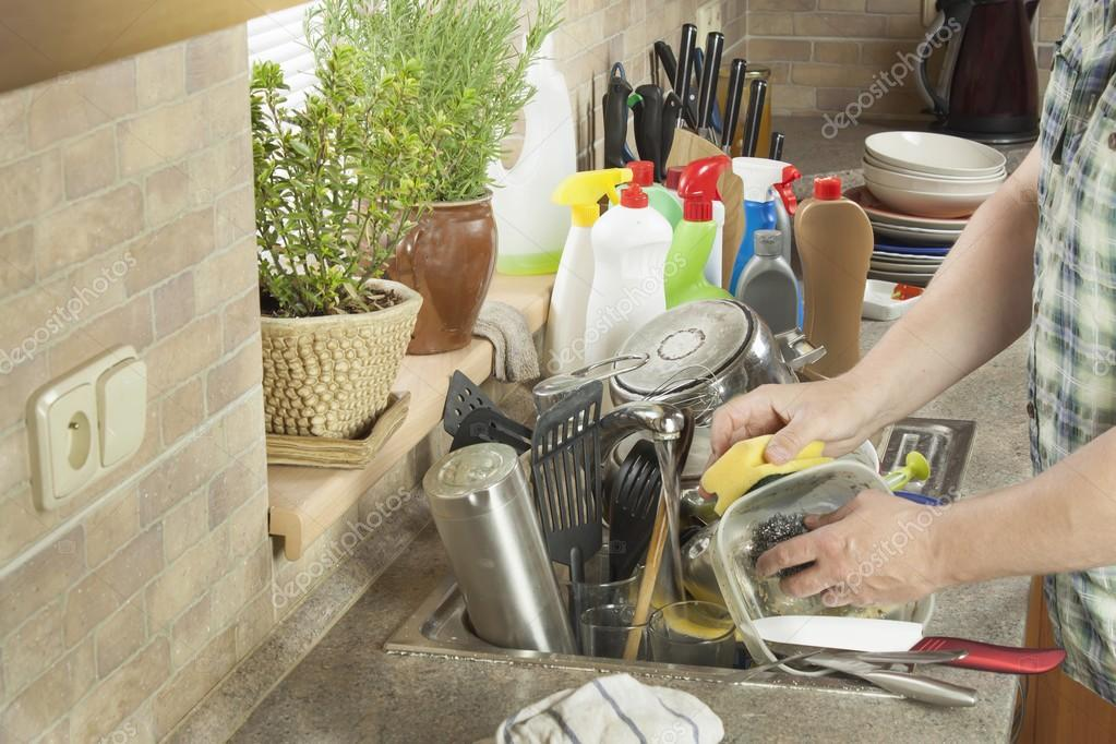 Dirty Kitchen Sink Man washing dirty dishes in the kitchen sink domestic cleaning up man washing dirty dishes in the kitchen sink domestic cleaning up after the party workwithnaturefo