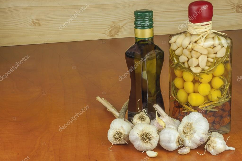 Garlic, aromatic ingredients for flavoring food. Home remedy for colds and flu. Garlic marinated in olive oil. Seasoning food. Preparing for the garden party and barbecue meat.