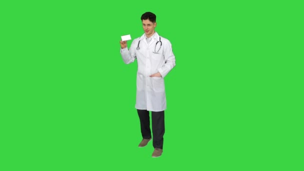 Medical doctor holding a box of pills promoting them and dancing on a Green Screen, Chroma Key.