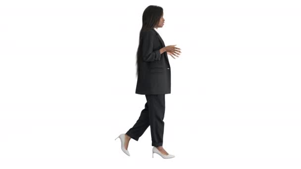 African American businesswoman explaining and gesturing while walking on white background.