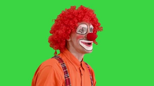 Klaun pomocí imaginární digitální nebo virtuální obrazovky na zelené obrazovce, Chroma Key.