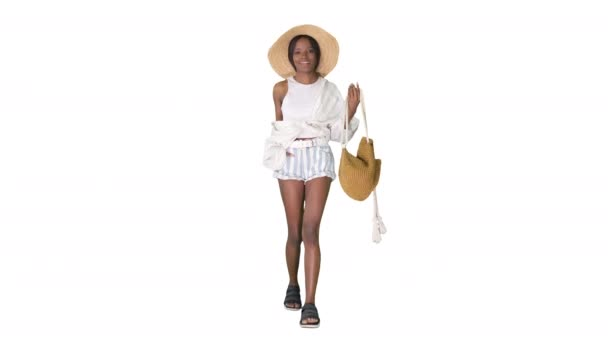 Summer in the city Beautiful african american woman wearing fashionable hat walking on white background.
