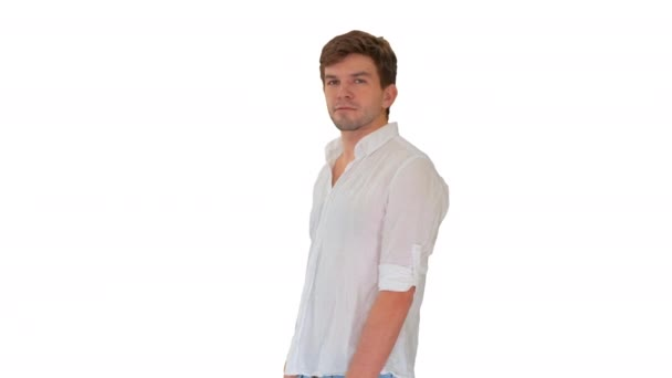 Casual young man looking at camera and talking about something on white background.