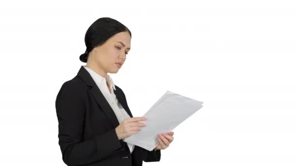 Serious Cute Businesswoman reading documents on white background.