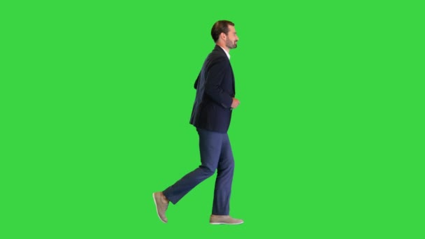 Handsome running businessman in a white shirt and a suit on a Green Screen, Chroma Key.