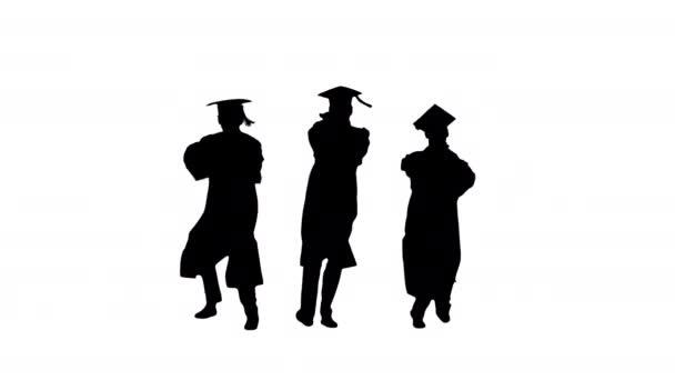 Silueta Tři absolventi v hábitech a minometech tančí synchronně.