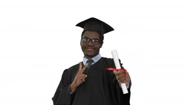 Happy african american male student in graduation robe posing with diploma for camera on white background.