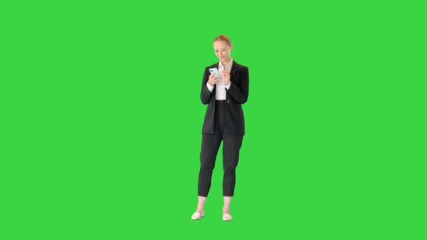 Pretty young, blonde woman viewing latest news and being surprised on a Green Screen, Chroma Key.