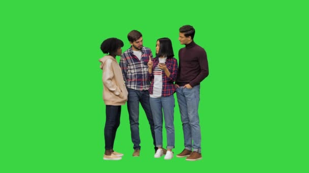 A young girl using her smartphones voice assistant to learn some information for her friends on a Green Screen, Chroma Key.