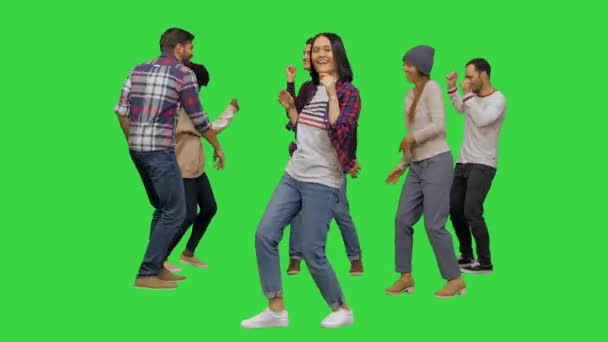 Young lively beautiful girl dancing with the others at the party on a Green Screen, Chroma Key.