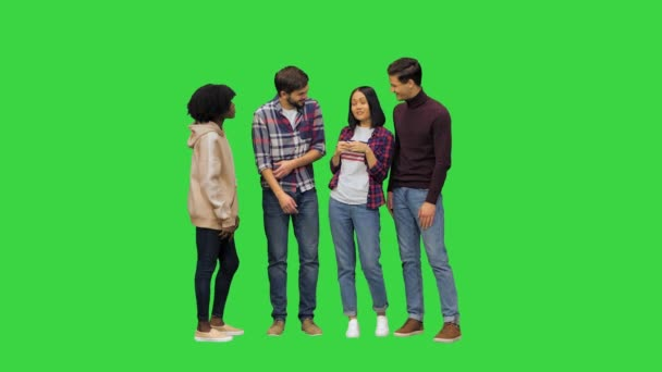 Young happy people chatting, telling funny things, joking, laughing, full size video on a Green Screen, Chroma Key.