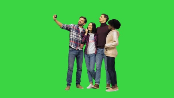 A group of cheerful students taking a selfie on a Green Screen, Chroma Key.