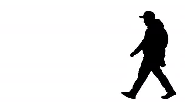 Silhouette Teenager school boy walking by and making hello gesture to camera.