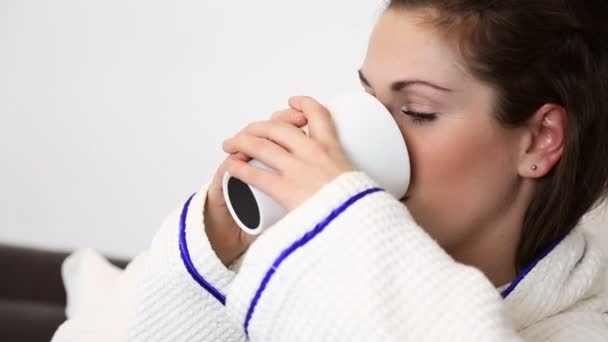 Woman drinking her morning coffee