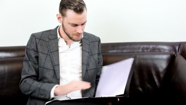 Businessman opening a folder working