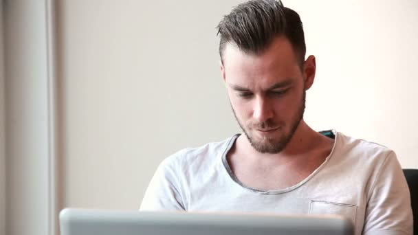Attractive student working on his laptop