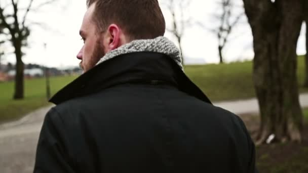 Man walking in park on a cold day in Sweden
