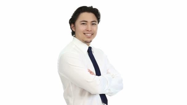junger, gutaussehender Geschäftsmann mit weißem Hemd und blauer Krawatte