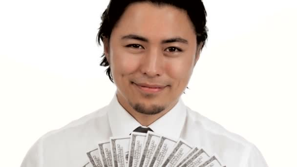 Close up of a man with lots of 100 dollar bills