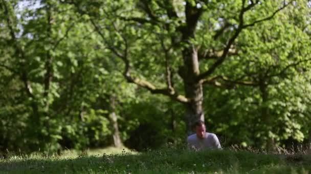 Man wearing a grey shirt walking up a hill