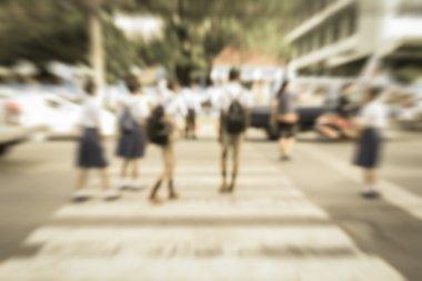 Blurred schoolchild walk crossing the street