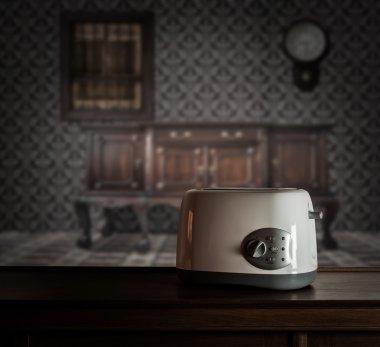 Toaster on wooden cupboard