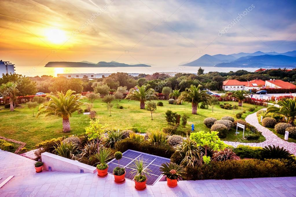 View of the landscaped garden in Dubrovnik and the sunset over the Adriatic Sea in front