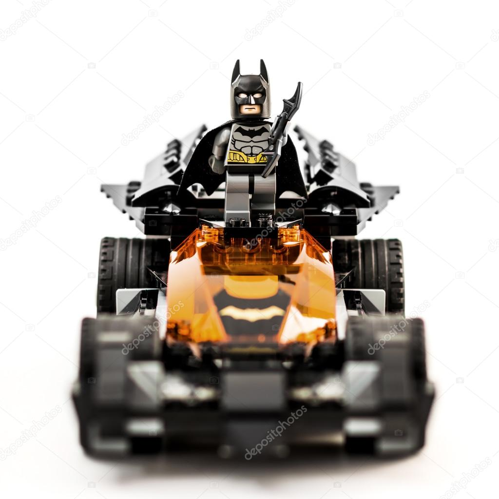 ZAGREB, CROATIA - DECEMBER 25, 2015: Lego toy Batman with Batmobile. Studio shot on white background.
