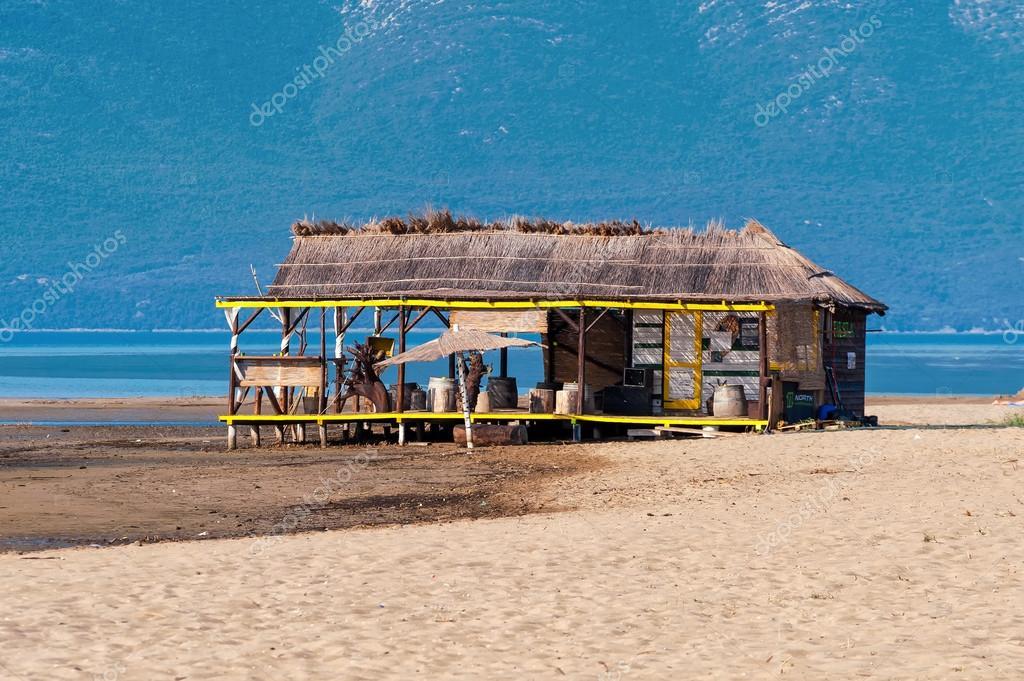 Lonely beach bar on the sandy beach by the sea
