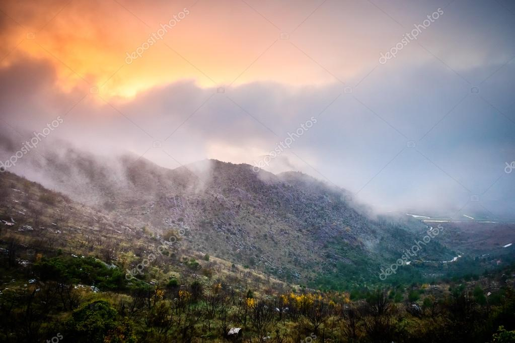 Fog and clouds in the high mountains and the sunlight that penet